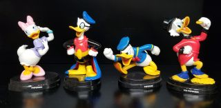 A Group of Eight Italian Disney Figurines. (Donald Duck, Uncle Scrooge, Mickey Mouse, Minnie...