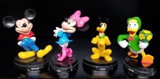 A Group of Eight Italian Disney Figurines. (Donald Duck, Uncle Scrooge, Mickey Mouse, Minnie Mouse, etc.)